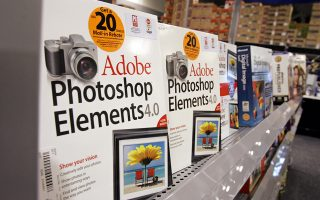 ** FILE ** Adobe Systems Inc. Photoshop Elements on display at a Best Buy store in a Mountain View, Calif. file photo from June 13, 2006. Adobe Systems, which makes the popular Acrobat and Photoshop software programs, said Thursday its third-quarter profit declined 54 percent, weighed down by stock options expenses and charges related to its acquisition of Macromedia. (AP Photo/Paul Sakuma, File)