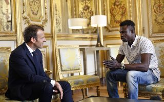 epa06768222 French President Emmanuel Macron (L) meets with Mamoudou Gassama from Mali, at the presidential Elysee Palace in Paris, France, 28 May 2018. The 22 year old migrant Mamoudou Gassama, who is living in France illegally, is being honored by Macron for scaling an apartment building over the weekend to save a 4-year-old child dangling from a fifth-floor balcony.  EPA/THIBAULT CAMUS / POOL MAXPPP OUT