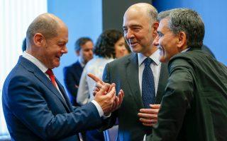 Τα ξημερώματα της Παρασκευής, ο Ολαφ Σολτς (αριστερά, με τους Πιερ Μοσκοβισί και Ευκλείδη Τσακαλώτο) έλεγε γεμάτος ικανοποίηση σε δημοσιογράφους ότι το αποτέλεσμα των πολύμηνων διαπραγματεύσεων ήταν συνέπεια ενός πολύ καλά προσχεδιασμένου πλάνου του Βερολίνου.