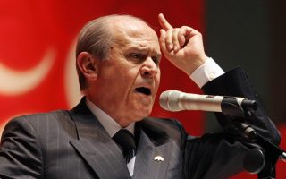 Devlet Bahceli, leader of Turkey's Nationalist Movement Party, MHP, one of the main opposition groups, addresses the national congress of his party in Ankara, Sunday, Nov. 19, 2006. The congress has re-elected Bahceli as MHP leader.(AP Photo/Burhan Ozbilici)