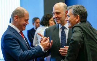 O Γερμανός υπουργός Οικονομικών Ολαφ Σολτς, ο Ευρωπαίος επίτροπος Οικονομικών Υποθέσεων Πιερ Μοσκοβισί και ο Ελληνας υπουργός Οικονομικών Ευκλείδης Τσακαλώτος στο ιστορικό, όπως χαρακτηρίστηκε, Eurogroup της Πέμπτης