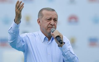 Turkey's President Recep Tayyip Erdogan, addresses supporters of his ruling Justice and Development Party (AKP) during a rally in Istanbul, Sunday, June 17, 2018. Turkey holds parliamentary and presidential elections on June 24, 2018 and is hugely important as it will transform Turkey's governing system to an executive presidency. (Presidency Press Service via AP, Pool)