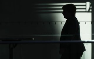 German Chancellor Angela Merkel walks between different rooms during exploratory  talks about a possible new government coalition between her Christian Union parties block, CDU/CSU. with the Green Party and the Free Democratic Party, FDP, at the Reichstag building in Berlin, Germany, Tuesday, Nov. 7, 2017. (AP Photo/Markus Schreiber)
