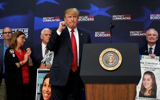 U.S. President Donald Trump gestures to his audience during an event featuring