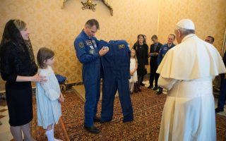 Pope Francis receives an astronaut suit from Italian astronaut Paolo Nespoli during a private meeting with crew members of the ISS 53 space mission at the Vatican June 8, 2018.  Vatican Media/Handout via REUTERS    ATTENTION EDITORS - THIS IMAGE WAS PROVIDED BY A THIRD PARTY