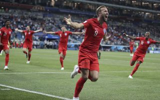 England's Harry Kane, center, celebrates after scoring during the group G match between Tunisia and England at the 2018 soccer World Cup in the Volgograd Arena in Volgograd, Russia, Monday, June 18, 2018. (AP Photo/Thanassis Stavrakis)
