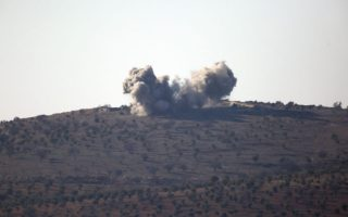 Smoke rises in the air from Turkish forces shelling inside Syria, as seen from the outskirts of the town of Kilis, Turkey, Tuesday, Jan. 30, 2018. Turkey launched a military offensive against the Kurdish enclave of Afrin on Jan. 20 to drive out the Syrian Kurdish People's Protection Units, or YPG, which is says are an extension of the outlawed Kurdish rebels inside Turkey. (AP Photo/Lefteris Pitarakis)
