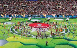 To 21o Παγκόσμιο Κύπελλο Ποδοσφαίρου βρίσκεται από χθες... καθ' οδόν με σημείο εκκίνησης τη Μόσχα και συγκεκριμένα το γήπεδο Λουζνίκι, όπου άνοιξε η αυλαία με μια φαντασμαγορική τελετή έναρξης και τη διοργανώτρια Ρωσία να συντρίβει την αδύναμη Σαουδική Αραβία με 5-0 στο μοναδικό ματς της ημέρας.