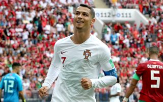 epa06824540 Cristiano Ronaldo of Portugal reacts during the FIFA World Cup 2018 group B preliminary round soccer match between Portugal and Morocco in Moscow, Russia, 20 June 2018.(RESTRICTIONS APPLY: Editorial Use Only, not used in association with any commercial entity - Images must not be used in any form of alert service or push service of any kind including via mobile alert services, downloads to mobile devices or MMS messaging - Images must appear as still images and must not emulate match action video footage - No alteration is made to, and no text or image is superimposed over, any published image which: (a) intentionally obscures or removes a sponsor identification image; or (b) adds or overlays the commercial identification of any third party which is not officially associated with the FIFA World Cup)  EPA/ABEDIN TAHERKENAREH   EDITORIAL USE ONLY
