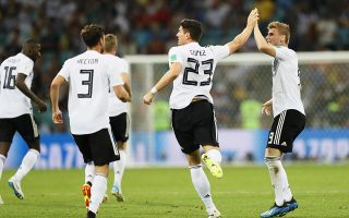 epa06834683 German players Mario Gomez (C) and Timo Werner (R) celebrate their team's 1-1 equalizer during the FIFA World Cup 2018 group F preliminary round soccer match between Germany and Sweden in Sochi, Russia, 23 June 2018.(RESTRICTIONS APPLY: Editorial Use Only, not used in association with any commercial entity - Images must not be used in any form of alert service or push service of any kind including via mobile alert services, downloads to mobile devices or MMS messaging - Images must appear as still images and must not emulate match action video footage - No alteration is made to, and no text or image is superimposed over, any published image which: (a) intentionally obscures or removes a sponsor identification image; or (b) adds or overlays the commercial identification of any third party which is not officially associated with the FIFA World Cup)  EPA/RONALD WITTEK   EDITORIAL USE ONLY