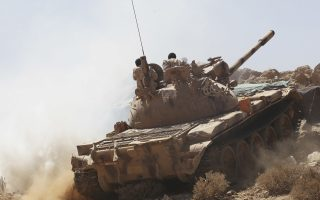 In this Friday, Feb. 2, 2018 photograph, Yemeni soldiers allied to the country's internationally recognized government drive a tank on the outskirts of Sanaa, Yemen. Yemen's conflict, which began as a civil war in 2014 and escalated into a regional proxy fight, drags on today. Winning the hardscrabble terrain takes time and costs dearly, only exacerbating the country's humanitarian crises and making a war that's seen over 10,000 people killed last that much longer. (AP Photo/Jon Gambrell)