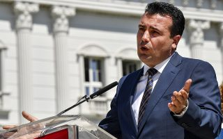 epa06772679 Macedonian Prime Minister Zoran Zaev addresses journalists during the press conference to mark the first year of his government's work in front of the Government building in Skopje, The Former Yugoslav Republic of Macedonia, 30 May 2018. Zaev said that he expect a telephone conversation with Greek Prime Minister Alexis Tsipras  'tonight, tomorrow or Friday', to make a step forward with negotiations for the name issues  in the next few days.  EPA/GEORGI LICOVSKI