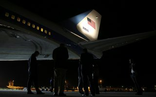 Journalists and White House staff stand under Air Force One, carrying U.S. President Donald Trump to Singapore for an anticipated summit with North Korea's leader Kim Jong Un, as it is stopped for a refuel in Chania, Greece June 10, 2018.  REUTERS/Jonathan Ernst