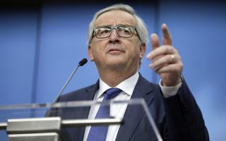 European Commission President Jean-Claude Juncker speaks during a media conference at the conclusion of an EU summit in Brussels on Friday, March 23, 2018. European Union leaders vented their frustration Friday that they only obtained a temporary exemption to U.S. tariffs on steel and aluminum and argue the measure should never have applied to their countries in the first place. (Olivier Matthys)