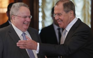 epa06803771 Russian Foreign Minister Sergei Lavrov (R) welcomes Greek Minister of Foreign Affairs Nikos Kotzias (L), during their meeting in Moscow, Russia, 13 June 2018.  EPA/YURI KOCHETKOV