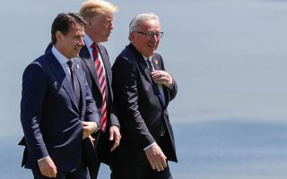 Italian Prime Minister Giuseppe Conte, U.S. President Donald Trump and European Commission President Jean-Claude Juncker arrive for a family photo at the G7 Summit in the Charlevoix city of La Malbaie, Quebec, Canada, June 8, 2018. REUTERS/Yves Herman
