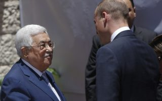 Britain's Prince William is welcomed by Palestinian President Mahmoud Abbas upon his arrival in the West Bank city of Ramallah, Wednesday, Jun 27, 2018. (AP Photo/Majdi Mohammed)