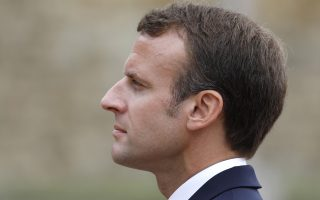 French President Emmanuel Macron pays attention during a WWII ceremony to mark the 78th anniversary of late French Gen. Charles de Gaulle's resistance call from London of June 18, 1940, at the Mont Valerien memorial in Suresnes, near Paris, France, Monday, June 18, 2018. (Charles Platiau/Pool Photo via AP)