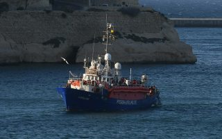 The ship operated by German aid group Mission Lifeline, carrying 234 migrants, arrives at the Valletta port in Malta, after a journey of nearly a week while awaiting permission to make landfall, Wednesday, June 27, 2018. Eight European nations agreed to accept the passengers who qualify as refugees. (AP Photo/Jonathan Borg)