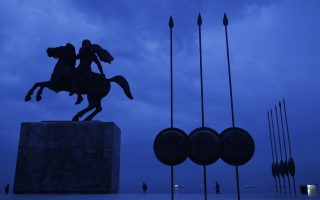 FILE - In this Wednesday, Oct, 8, 2014 file photo, a modern bronze statue of Alexander the Great is flanked by copies of round shields and the Macedonian infantry's Sarissa pikes, in the northern port city of Thessaloniki, Greece.  Officials in Greece and Macedonia say Tuesday, June 12, 2018, they are close to reaching a landmark deal on a long-standing name dispute, to protect Greece's region of Macedonia, birthplace of ancient warrior king Alexander the Great, but the Greek coalition partner has vowed to vote against the proposed agreement.  (AP Photo/Petros Giannakouris, File)