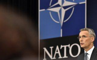 NATO Secretary General Jens Stoltenberg speaks during a media conference at NATO headquarters in Brussels on Thursday, April 26, 2018. (AP Photo/Geert Vanden Wijngaert)