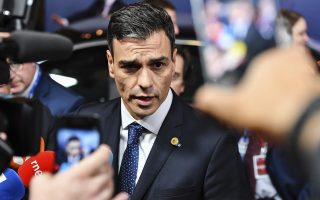 Spain's Prime Minister Pedro Sanchez talks with journalists as he leaves an EU summit in Brussels, early Friday, June 29, 2018. European Union leaders claimed a breakthrough deal on Friday on how to deal with the pressure of migration after all-night talks helped accommodate Italian demands for more help.  (AP Photo/Geert Vanden Wijngaert)