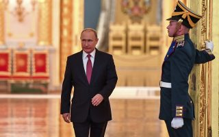 Russian President Vladimir Putin enters a hall to attend the State Prize awards ceremony marking the Day of Russia at the Grand Kremlin Palace in Moscow, Russia, Tuesday, June 12, 2018. Since 1992 the Day of Russia is annually celebrated on 12 June as the Russian Federation's national holiday. (Yuri Kadobnov/Pool Photo via AP)