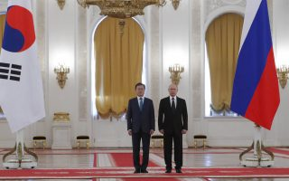Russian President Vladimir Putin, right, and South Korean President Moon Jae-in attend an official welcome ceremony prior to their talks at the Kremlin in Moscow, Russia, Friday, June 22, 2018. South Korean President is in Moscow on a state visit intended to boost bilateral economic ties. (Sergei Karpukhin/Pool Photo via AP)