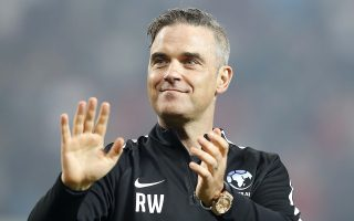 England's Robbie Williams acknowledges fans after the final whistle during the UNICEF Soccer Aid match at Old Trafford, Manchester, Sunday June 10, 2018.   (Martin Rickett/PA via AP)