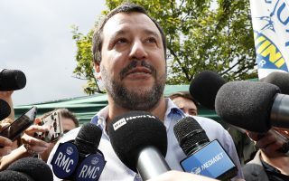 FILE - In this Saturday, May 19, 2018 file photo, the League party leader, Matteo Salvini, meets reporters in Milan, Italy. One of Italy's two main populist leaders says he and his rival have finally agreed on who should be premier, and it's neither of them. Exactly 11 weeks after elections resulted in political gridlock, League leader Matteo Salvini told reporters Sunday he and 5-Star Movement leader Luigi Di Maio have snagged a deal on both who should head Italy's next government and choice of Cabinet ministers. (AP Photo/Antonio Calanni, File )