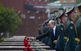 Russian President Vladimir Putin, center, takes part in a wreath laying ceremony to the Tomb of Unknown Soldier in Moscow, Russia, Friday, June 22, 2018, marking the 77th anniversary of the Nazi invasion of the Soviet Union. (Alexei Druzhinin, Sputnik, Kremlin Pool Photo via AP)