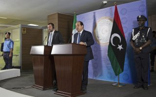 Ahmed Maiteeg, the deputy prime minister of the U.N.-backed Libyan government, center, and the Italian Interior Minister Matteo Salvini give a press conference, in the prime ministry building, in Tripoli, Monday, June 25th, 2018. (AP Photo/Mohamed Ben Khalifa)