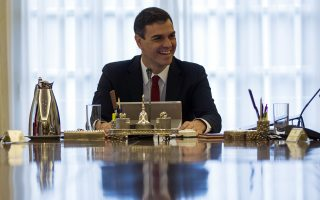 Spain's new Prime Minister Pedro Sanchez, centre, cmiles during the first Cabinet meeting of the new government at the Moncloa palace in Madrid, Friday, June 8, 2018. (AP Photo/Francisco Seco)