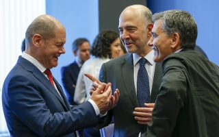 epa06827490 (L-R) German Finance Minister Olaf Scholz, European Commissioner for Economic and Financial Affairs, Pierre Moscovici and Greek Finance Minister Euclid Tsakalotos during a meeting of the Eurogroup in Luxembourg, 21 June 2018. The Eurogroup will assess the progress achieved by Greece in implementing the prior actions required under the fourth (and the final) review of its programme.  EPA/JULIEN WARNAND