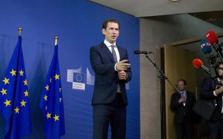 Austrian Chancellor Sebastian Kurz speaks with the media as he arrives for an informal EU summit on migration at EU headquarters in Brussels, Sunday, June 24, 2018. (AP Photo/Virginia Mayo)