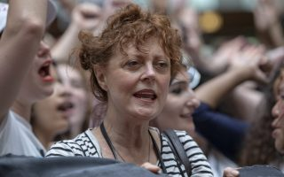 Hundreds of activists, including actress Susan Sarandon, center, challenge the Trump administration's approach to illegal border crossings and separation of children from immigrant parents, in the Hart Senate Office Building on Capitol Hill in Washington, Thursday, June 28, 2018. (AP Photo/J. Scott Applewhite)