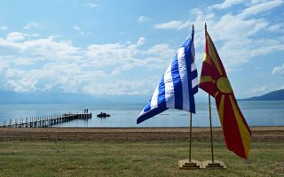 epa06814777 The flags of Greece (L) and the Former Yugoslav Republic of Macedonian (R) stand at the shores of Lake Prespes near Otesevo, the Former Yugoslav Republic of Macedonia (FYROM), 17 Junie 2018. Prime Ministers from Greece and Macedonia meet in the Prespes lake district, that borders both countries, to sign an agreement aimed at ending a decades-long dispute between their countries. The agreement shall lead to the renaming of Greece's northern neighbour, as well as its EU and NATO entry.  EPA/Nake Batev