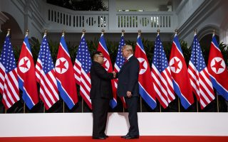 President Donald Trump shakes hands as he meets with North Korean leader Kim Jong Un on Sentosa Island, Tuesday, June 12, 2018, in Singapore. (AP Photo/Evan Vucci)