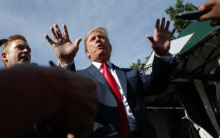 President Donald Trump speaks to reporters on the North Lawn of the White House, Friday, June 15, 2018, in Washington. (AP Photo/Evan Vucci)