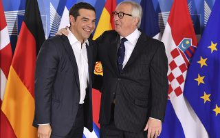European Commission President Jean-Claude Juncker, right, speaks with Greek Prime Minister Alexis Tsipras during an informal EU summit on migration at EU headquarters in Brussels, Sunday, June 24, 2018. (AP Photo/Geert Vanden Wijngaert, Pool)