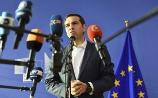 Greek Prime Minister Alexis Tsipras speaks with the media at the conclusion of an informal EU summit on migration at EU headquarters in Brussels, Sunday, June 24, 2018. (AP Photo/Geert Vanden Wijngaert)