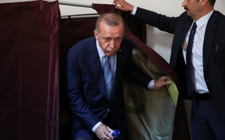 Turkish President Tayyip Erdogan leaves the voting booth at a polling station in Istanbul, Turkey June 24, 2018. REUTERS/Umit Bektas