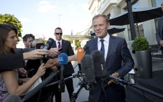 European Council President Donald Tusk, right, speaks with the media outside a hotel prior to an EU summit in Bratislava on Thursday, Sept. 15, 2016. An EU summit, without the participation of the United Kingdom, in Bratislava will kick off on Friday with discussions on the future of the EU following Brexit. (AP Photo/Virginia Mayo)