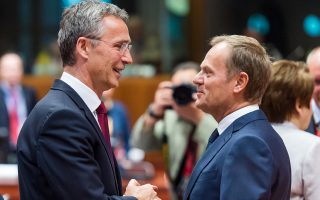 European Council President Donald Tusk, right, speaks with NATO Secretary General Jens Stoltenberg during a round table meeting at an EU summit in Brussels on Friday, June 26, 2015. EU leaders, in a second day of meetings, will discuss migration, the Greek bailout and European defense. (AP Photo/Geert Vanden Wijngaert)