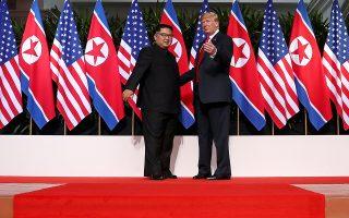 U.S. President Donald Trump and North Korean leader Kim Jong Un react at the Capella Hotel on Sentosa island in Singapore June 12, 2018. REUTERS/Jonathan Ernst