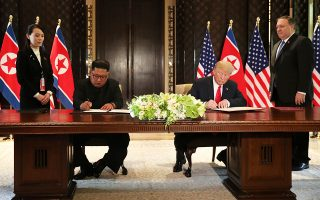 U.S. President Donald Trump and North Korea's leader Kim Jong Un sign documents that acknowledge the progress of the talks and pledge to keep momentum going, after their summit at the Capella Hotel on Sentosa island in Singapore June 12, 2018. REUTERS/Jonathan Ernst