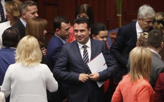 Macedonian Prime Minister Zoran Zeav, center, looks on after the Macedonian parliament ratified a deal with Greece during a session in the parliament in Skopje, Macedonia, Wednesday, June 20, 2018. The Macedonian parliament is debating on a plenary session a law on ratifying a deal with Greece, signed with aim to end a decades-long spat over the Macedonia's name. (AP Photo/Boris Grdanoski)