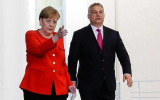 Η Γερμανίδα καγκελάριος Αγκελα Μέρκελ και ο Ούγγρος πρωθυπουργός Βίκτορ Ορμπαν, στη χθεσινή συνέντευξη Τύπου στο Βερολίνο.