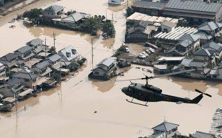 A helicopter flies over Mabi town which was flooded by the heavy rain in Kurashiki, Okayama Prefecture, Japan, in this photo taken by Kyodo July 9, 2018. Mandatory credit Kyodo/via REUTERS ATTENTION EDITORS - THIS IMAGE WAS PROVIDED BY A THIRD PARTY. MANDATORY CREDIT. JAPAN OUT.