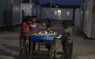 Children play table soccer in the refugee camp of Ritsona about 86 kilometers (53 miles) north of Athens, during the World Refugee Day, Wednesday, June 20, 2018. World Refugee Day, launched by the UN Refugee Agency, and held every year on June 20th, aims to honor the courage of people who are forced to flee their homeland. (AP Photo/Petros Giannakouris)